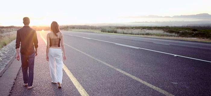 Couple Walking on Side of Road