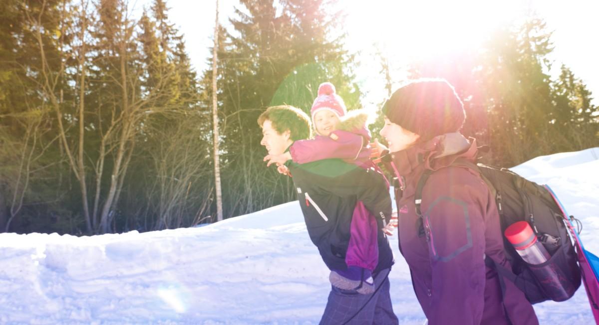 Family walking outdoors in winter