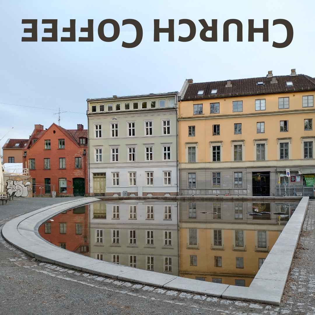 """Picture of Oslo buildings with """"Church Coffee"""" written upside-down"""